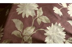 BROWN FABRIC WITH LARGE FLOWER DESIGN PRICE IS PER  ROLL END OF 7MTR